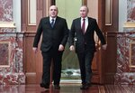 Russian President Vladimir Putin, right, and new Russian Prime Minister Mikhail Mishustin arrive to attend a new cabinet meeting in Moscow, Russia, Tuesday, Jan. 21, 2020. Putin formed his new Cabinet Tuesday, replacing many of its members but keeping his foreign, defense and finance ministers in place. (Alexei Nikolsky, Sputnik, Kremlin Pool Photo via AP)