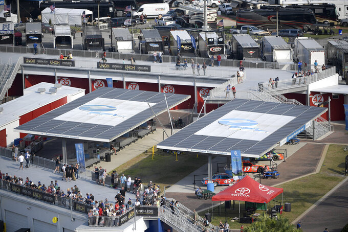 Solar arrays help power the Florida Power & Light Solar Circuit and provide shade in the infield during a NASCAR Xfinity Series auto race at Daytona International Speedway Saturday, Feb. 16, 2019, in Daytona Beach, Fla. (AP Photo/Phelan M. Ebenhack)