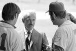 FILE - In this March 11, 1972, file photo, Marvin Miller, executive director of the Major League Baseball Players Association, talks to New York Mets Tom Seaver, left, and Ed Kranepool in St. Petersburg, Fla., after Mets players voted for a baseball strike if players' contract demands are not met by deadline on March 31. Ahead of Miller's induction Wednesday into the Hall of Fame, union leaders say his philosophies and strategies still make up the union's foundation. (AP Photo/File)