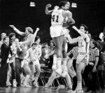 FILE - In this March 29, 1982, file photo, Sam Perkins (41) and James Worthy of North Carolina jump in the air after they defeated Georgetown 63-62 to win the NCAA Final Four college basketball championship at the Superdome in New Orleans. At far left gesturing is coach Dean Smith. (Ellis Lucia/The Times-Picayune/The New Orleans Advocate, File)