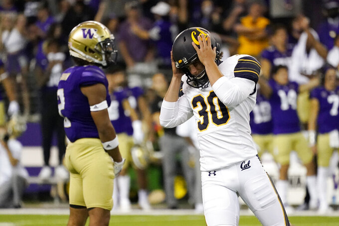 California's Dario Longhetto (30) heads back to the sidelines after missing an attempted field goal against Washington at the end of the second half of an NCAA college football game Saturday, Sept. 25, 2021, in Seattle. Washington won 31-24 in overtime. (AP Photo/Elaine Thompson)