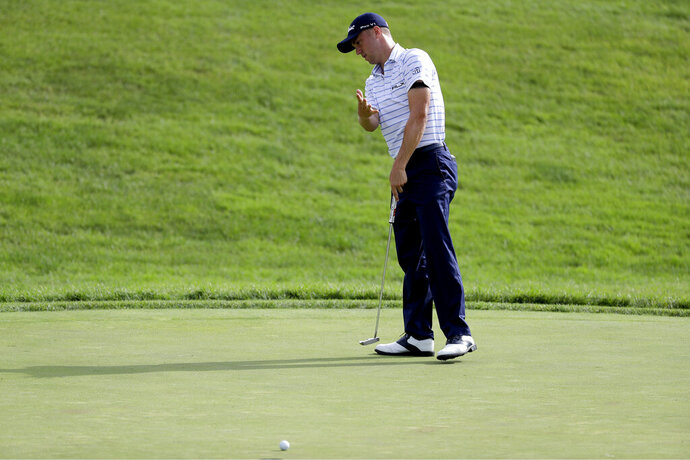 Justin Thomas reacts to missing his birdie putt on the 18th green during the third round of the Workday Charity Open golf tournament, Saturday, July 11, 2020, in Dublin, Ohio. (AP Photo/Darron Cummings)