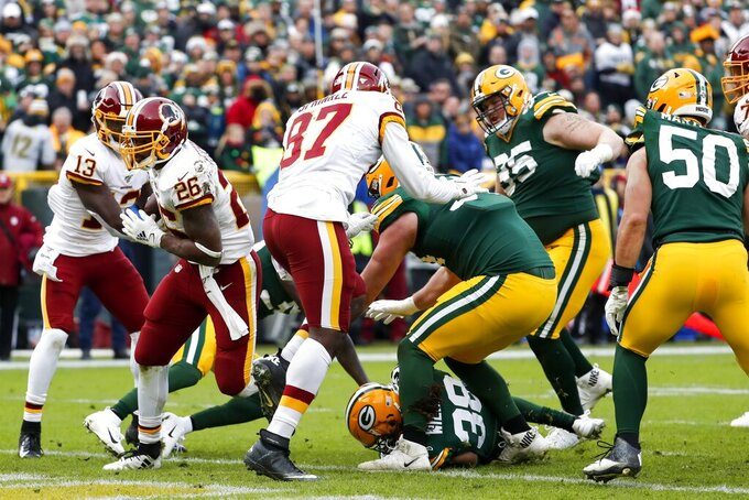 Washington Redskins' Adrian Peterson runs for a touchdown during the first half of an NFL football game against the Green Bay Packers Sunday, Dec. 8, 2019, in Green Bay, Wis. (AP Photo/Matt Ludtke)