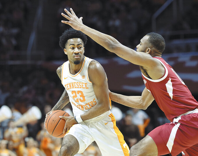 Tennessee's Jordan Bowden (23) leads the Vols' offense against Arkansas during an NCAA college basketball game, in Knoxville, Tenn., Tuesday, Feb. 11, 2020. (Scott Keller/The Daily Times via AP)