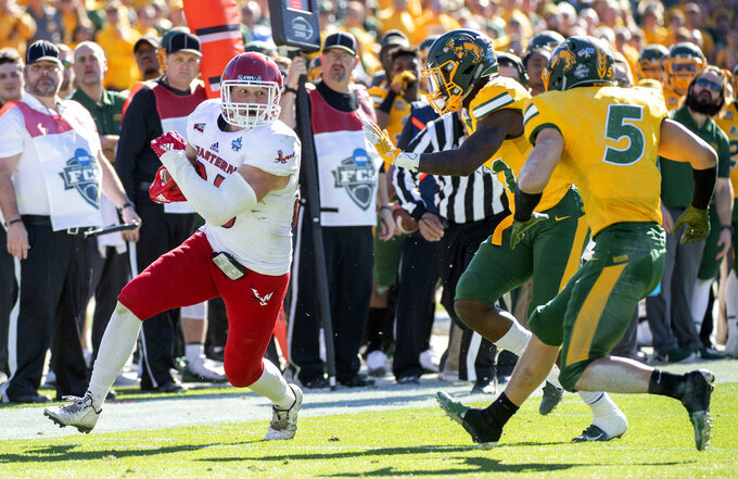 Eastern Washington tight end Jayce Gilder (89) turns upfield against North Dakota State cornerback Jalen Allison (21) and safety Robbie Grimsley (5) during the first half of the FCS championship NCAA college football game, Saturday, Jan. 5, 2019, in Frisco, Texas. (AP Photo/Jeffrey McWhorter)
