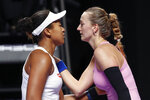 Naomi Osaka of Japan, left, is congratulated by Petra Kvitova of the Czech Republic after their WTA Finals Tennis Tournament in Shenzhen, China's Guangdong province, Sunday, Oct. 27, 2019. (AP Photo/Andy Wong)