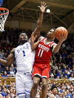 Duke's Zion Williamson (1) defends North Carolina State's Markell Johnson (11) during the first half of an NCAA college basketball game in Durham, N.C., Saturday, Feb. 16, 2019. (AP Photo/Chris Seward)