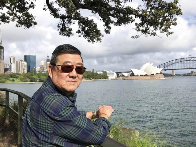 "This March 2020 photo provided by the family shows Ming Wang in Sydney, Australia. The 71-year-old was sickened in March on a cruise from Australia with his wife, a break after decades of running the family's Chinese restaurant in Papillion, Neb. In the 74 days he was hospitalized, doctors desperately tried various experimental approaches, including enrolling him in a study of an antiviral drug that ultimately showed promise. Ming died on June 8. ""It was just touch and go. Everything they wanted to try we said yes, do it,"" said his daughter, Anne Peterson. ""We would give anything to have him back, but if what we and he went through would help future patients, that's what we want."" (Lu Wang via AP)"