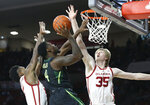 Baylor guard Mario Kegler (4) shoots between Oklahoma forward Kristian Doolittle, left, and forward Brady Manek (35) in the first half of an NCAA college basketball game in Norman, Okla., Monday, Jan. 28, 2019. (AP Photo/Sue Ogrocki)