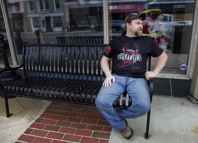 U.S. Marine Corps veteran Chad Sneary, 43, sits on a bench. Sneary was laid off from his manufacturing job in April. Sneary waits for unemployment to come through.