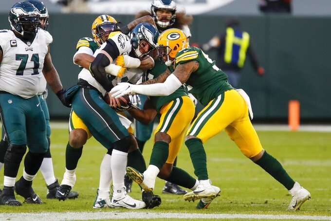 Philadelphia Eagles' Carson Wentz is sacked during the first half of an NFL football game against the Green Bay Packers Sunday, Dec. 6, 2020, in Green Bay, Wis. (AP Photo/Matt Ludtke)