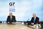 British Prime Minister Boris Johnson, left and US President Joe Biden sit around the table at the top of the G7 meeting, in Carbis Bay, Cornwall, England, Friday, June 11, 2021. (Leon Neal/Pool Photo via AP)