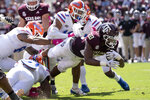 Texas A&M running back Isaiah Spiller (28) dives over the goal line for a touchdown against Florida during the second half of an NCAA college football game, Saturday, Oct. 10, 2020. in College Station, Texas. (AP Photo/Sam Craft)