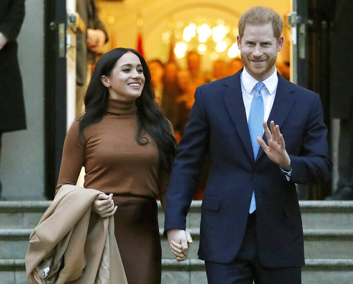 FILE - Prince Harry and Meghan, the Duke and Duchess of Sussex, leave after visiting Canada House on Jan. 7, 2020, in London. The royal couple and guests from Elton John to their son Archie appear on their new podcast's first audio release on Tuesday, Dec. 29, 2020, for Spotify, a 34-minute special with reflections on 2020.  (AP Photo/Frank Augstein, File)