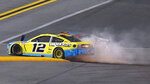 Drivers Ryan Blaney (12) and Chase Elliott (9) crash during the final lap of the NASCAR Daytona Clash auto race Tuesday, Feb. 9, 2021, at Daytona International Speedway in Daytona Beach, Fla. (AP Photo/Chris O'Meara)