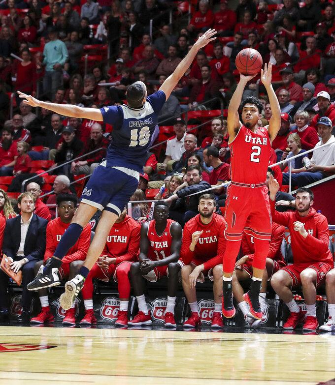 Utah guard Sedrick Barefield (2) shoots the ball over Nevada forward Caleb Martin (10) during the second half of an NCAA college basketball game, Saturday, Dec. 29, 2018, in Salt Lake City. Nevada won 86-71. (AP Photo/Chris Nicoll)
