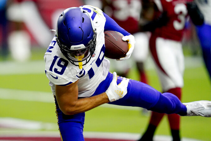 Minnesota Vikings wide receiver Adam Thielen (19) pulls in a touchdown pass against the Arizona Cardinals during the first half of an NFL football game, Sunday, Sept. 19, 2021, in Glendale, Ariz. (AP Photo/Ross D. Franklin)
