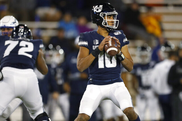 FILE - In this Oct. 26, 2019, file photo, Utah State quarterback Jordan Love looks for a receiver during the team's NCAA college football game against Air Force at Air Force Academy, Colo. The Green Bay Packers selected Love in the first round of the NFL draft Thursday, April 23, 2020. (AP Photo/David Zalubowski, File)