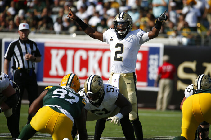 New Orleans Saints quarterback Jameis Winston (2) calls signals during the first half of an NFL football game against the Green Bay Packers, Sunday, Sept. 12, 2021, in Jacksonville, Fla. (AP Photo/Stephen B. Morton)