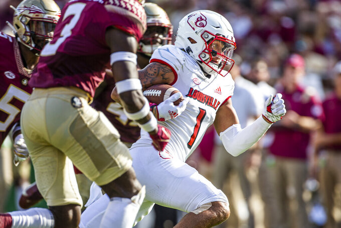 Louisville wide receiver Jordan Watkins scores late first half of an NCAA college football game against Florida State in Tallahassee, Fla., Saturday, Sept. 25, 2021. (AP Photo/Mark Wallheiser)