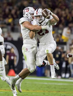 Stanford's Sean Barton (27) celebrates his interception against Arizona State with teammate Dylan Jackson during the first half of an NCAA college football game Thursday, Oct. 18, 2018, in Tempe, Ariz. (AP Photo/Darryl Webb)
