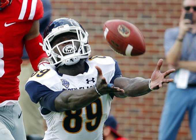 FILE - In this Sept. 22, 2018, file photo, Kent State wide receiver Antwan Dixon (89) dives for an incomplete pass during the first half of an NCAA college football game Mississippi in Oxford, Miss. After missing two whole seasons, Dixon is back with Kent State and one 15 nominees so far for the college football's new Comeback Player of the Year Award. (AP Photo/Rogelio V. Solis, File)