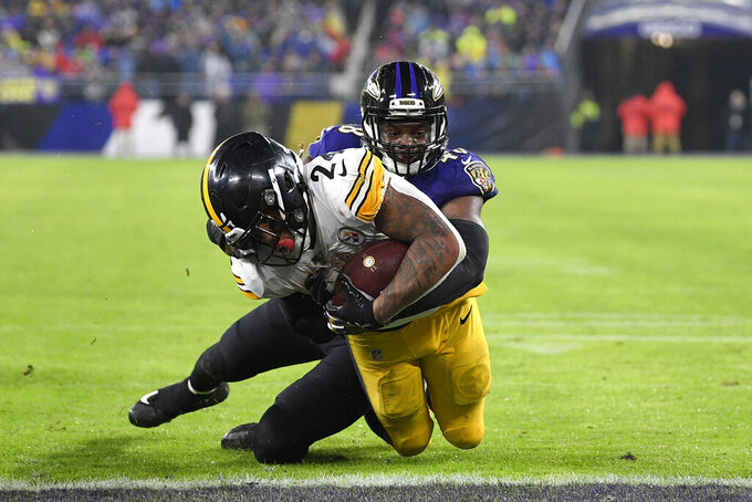 Pittsburgh Steelers running back Benny Snell, front, dives into the end zone as Baltimore Ravens inside linebacker Patrick Onwuasor tries to stop him while scoring a rushing touchdown during the first half of an NFL football game, Sunday, Dec. 29, 2019, in Baltimore. (AP Photo/Nick Wass)