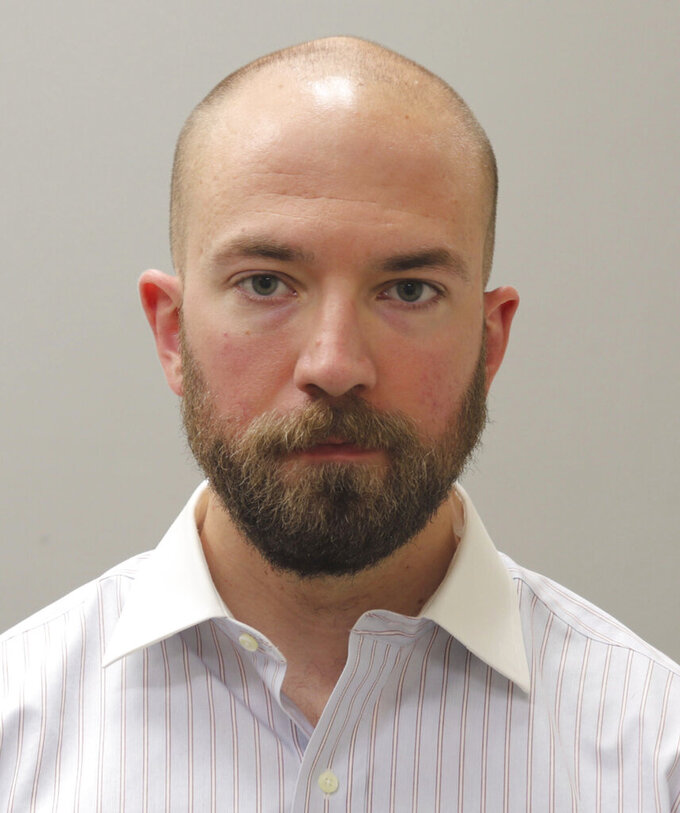 FILE - This booking photograph from Friday, May 7, 2021, shows Huntsville, Ala., police officer William Darby, who was convicted of murder in a fatal shooting that happened in 2018.   Darby resigned on Friday, July 23, after being paid by the city for more than two months after his murder conviction.(Madison County Sheriff's Office via AP, File)