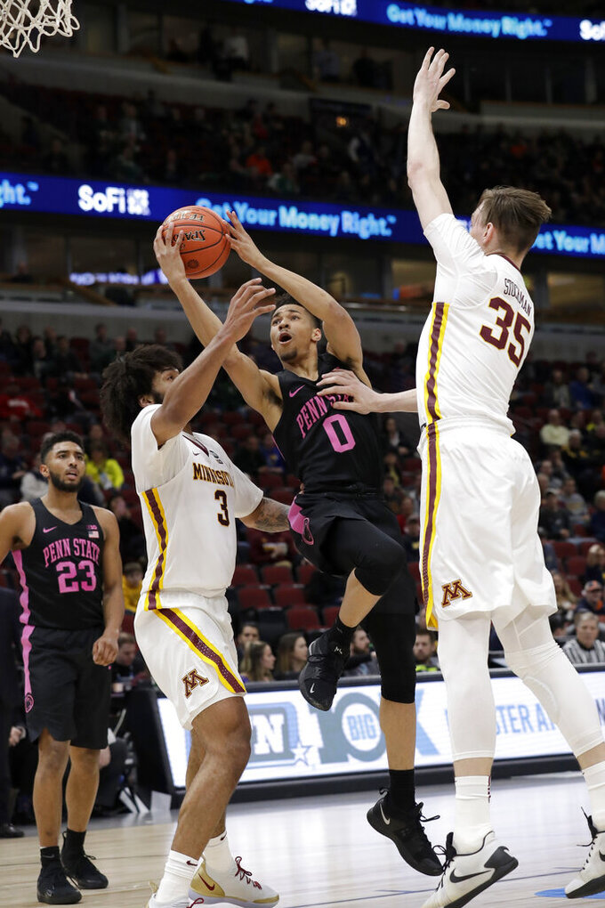 Penn State's Myreon Jones (0) takes a shot against Minnesota's Jordan Murphy (3) and Matz Stockman (35) during the first half of an NCAA college basketball game in the second round of the Big Ten Conference tournament, Thursday, March 14, 2019, in Chicago. (AP Photo/Nam Y. Huh)