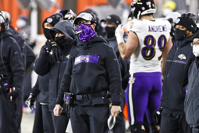 Baltimore Ravens head coach John Harbaugh watches during the first half of an NFL football game against the Cleveland Browns, Monday, Dec. 14, 2020, in Cleveland. (AP Photo/Ron Schwane)