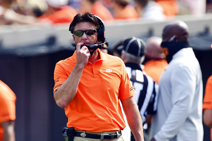 FILE- In this Sept. 19, 2020, file photo, Oklahoma State head coach Mike Gundy watches during the first half of an NCAA college football game against Tulsa, Saturday, in Stillwater, Okla. (AP Photo/Brody Schmid, File)