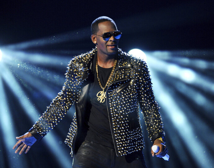 In this June 30, 2013 file photo, R. Kelly performs at the BET Awards in Los Angeles. Kelly, one of the top-selling recording artists of all time, has been hounded for years by allegations of sexual misconduct involving women and underage girls _ accusations he and his attorneys have long denied. But an Illinois prosecutor's plea for potential victims and witnesses to come forward has sparked hope among some advocates that the R&B star might face new charges. (Photo by Frank Micelotta/Invision/AP, File)