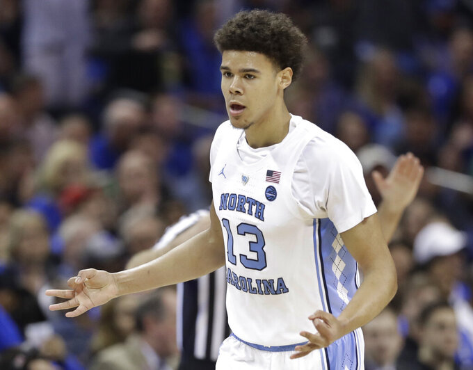 North Carolina's Cameron Johnson (13) gestures after making a 3-point basket against Duke during the first half of an NCAA college basketball game in the Atlantic Coast Conference tournament in Charlotte, N.C., Friday, March 15, 2019. (AP Photo/Chuck Burton)