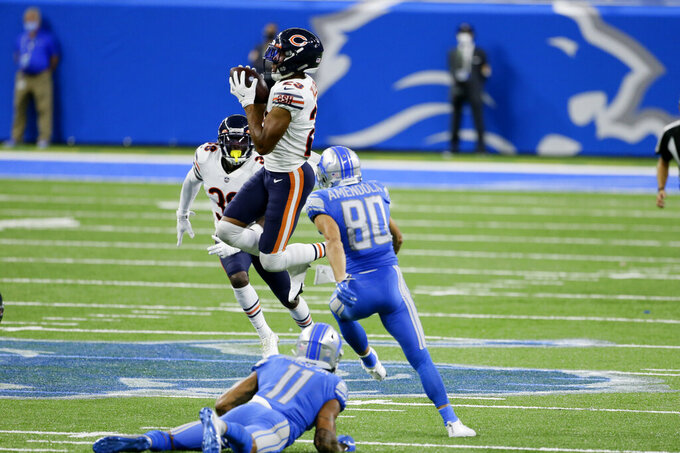 Chicago Bears cornerback Kyle Fuller (23) intercepts a Detroit Lions quarterback Matthew Stafford (9) pass in the fourth quarter of an NFL football game in Detroit, Sunday, Sept. 13, 2020. Chicago won 27-23. (AP Photo/Duane Burleson)