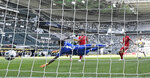 Moenchengladbach's Marcus Thuram, second left, scores his side's second goal against Berlin keeper Rafal Gikiewicz during the German Bundesliga soccer match between Borussia Moenchengladbach and Union Berlin in Moenchengladbach, Germany, Sunday, May 31, 2020. The German Bundesliga becomes the world's first major soccer league to resume after a two-month suspension because of the coronavirus pandemic. (AP Photo/Martin Meissner, Pool)