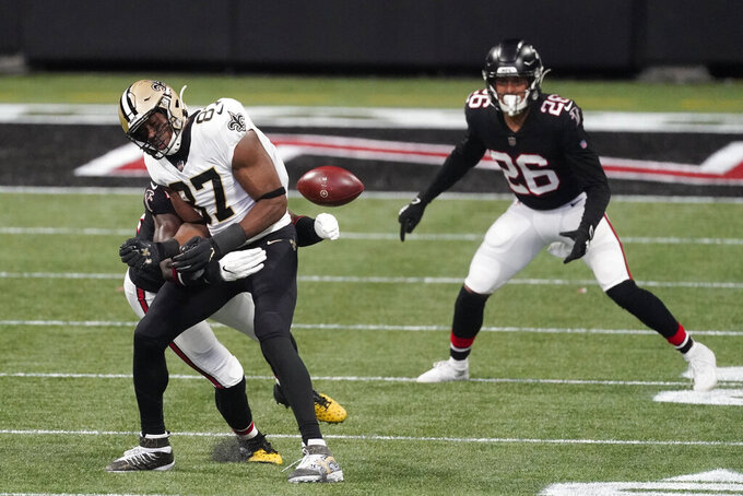 Atlanta Falcons linebacker Foye Oluokun (54) hits New Orleans Saints tight end Jared Cook (87) during the first half of an NFL football game, Sunday, Dec. 6, 2020, in Atlanta. (AP Photo/John Bazemore)