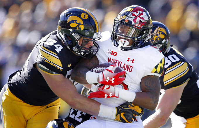 Maryland running back Anthony McFarland is tacked by Iowa linebacker Kristian Welch (34) during the first half of an NCAA college football game, Saturday, Oct. 20, 2018, in Iowa City, Iowa. (AP Photo/Charlie Neibergall)