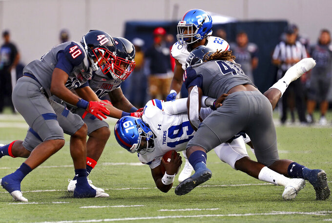 Tennessee State quarterback Geremy Hickbottom (19) gets sacked by Jackson State during the Southern Heritage Classic NCAA college football game in Memphis, Tenn., Saturday, Sept. 11, 2021. (Patrick Lantrip/Daily Memphian via AP)