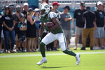 FILE - In this Sept. 30, 2018, file photo, New York Jets receiver Andre Roberts (19) warms up before an NFL football game against the Jacksonville Jaguars, in Jacksonville, Fla. A person familiar with the discussions confirms to The Associated Press that the Buffalo Bills have agreed to sign return specialist and receiver Andre Roberts. The person spoke to the AP on Thursday, March 14, 2019, on the condition of anonymity because the contract has not yet been signed. (AP Photo/Phelan M. Ebenhack, File)