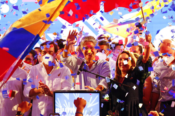 Guillermo Lasso, presidential candidate of Creating Opportunities party, CREO, celebrates after a presidential runoff election at his campaign headquarters in Guayaquil, Ecuador, Sunday, April 11, 2021. With most of the votes counted Lasso, a former banker, had a lead over economist Andres Arauz, a protege of former President Rafael Correa.(AP Photo/Angel Dejesus)