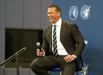 Baseball great Alex Rodriguez laughs during a press conference after Minnesota Timberwolves team owner Glen Taylor introduced Rodriguez and Marc Lore as the new ownership partners of the NBA Timberwolves basketball team, Monday, Sept. 27, 2021, in Minneapolis (AP Photo/Jim Mone)