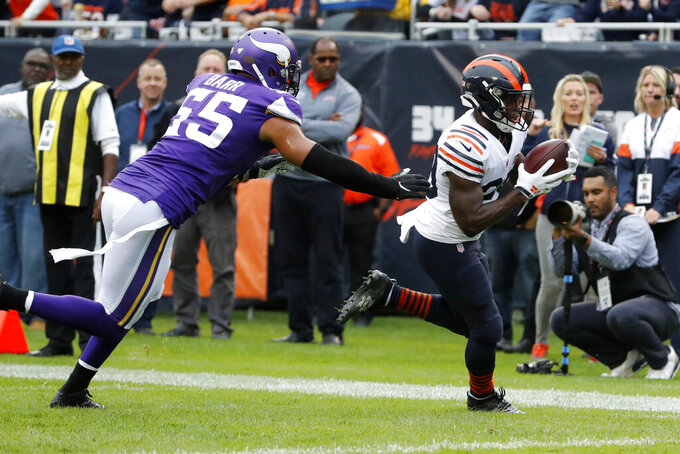 Chicago Bears running back Tarik Cohen, right, catches a 10-yard pass for a touchdown as Minnesota Vikings outside linebacker Anthony Barr (55) defends during the half of an NFL football game Sunday, Sept. 29, 2019, in Chicago. (AP Photo/Charles Rex Arbogast)