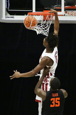 Washington State center Efe Abogidi (0) dunks in front of Oregon State forward Dearon Tucker (35) during the second half of an NCAA college basketball game in Pullman, Wash., Wednesday, Dec. 2, 2020. Washington State won 59-55. (AP Photo/Young Kwak)