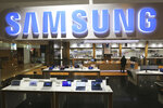 A logo of Samsung Group is seen at its shop in Seoul, South Korea, Thursday, Jan. 30, 2020. Samsung Electronics Co. said Thursday its operating profit for the last quarter fell 33.7% from a year earlier but it predicted earnings will improve in 2020, driven by a gradually stabilizing computer chip market and increasing 5G smartphone sales. (AP Photo/Ahn Young-joon)
