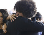 Family and friends hug during a memorial for Christopher Morgan at West Orange High School in West Orange, N.J., Tuesday, June 11, 2019. West Point officials have said Morgan died Thursday when a tactical vehicle carrying cadets overturned in wooded terrain. Nineteen cadets and two soldiers operating the vehicle sustained non-life-threatening injuries. (Alexandra Pais/NJ Advance Media via AP)