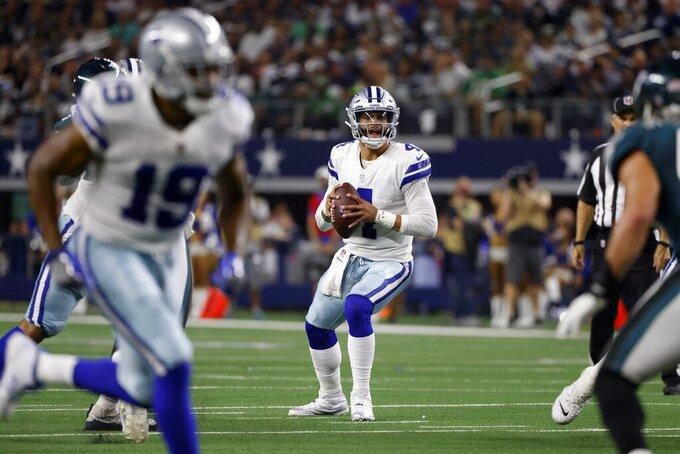 Dallas Cowboys wide receiver Amari Cooper (19) runs a route as quarterback Dak Prescott (4) prepares to throw a pass in the first half of an NFL football game against the Philadelphia Eagles in Arlington, Texas, Monday, Sept. 27, 2021. (AP Photo/Ron Jenkins)