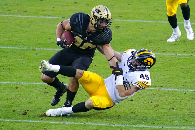 Purdue running back Zander Horvath (40) is tackled by Iowa linebacker Nick Niemann (49) during the third quarter of an NCAA college football game in West Lafayette, Ind., Saturday, Oct. 24, 2020. (AP Photo/Michael Conroy)