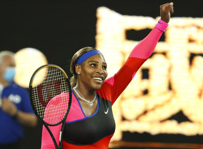 United States' Serena Williams celebrates after defeating Romania's Simona Halep during their quarterfinal match at the Australian Open tennis championship in Melbourne, Australia, Tuesday, Feb. 16, 2021.(AP Photo/Hamish Blair)