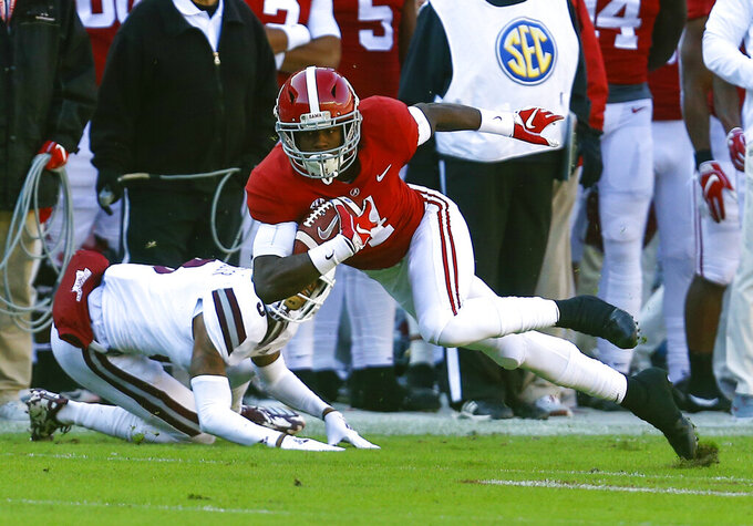 FILE - In this Nov. 10, 2018, file photo, Alabama wide receiver Jerry Jeudy (4) carries the ball after a reception over Mississippi State cornerback Cameron Dantzler (3) during the first half of an NCAA college football game in Tuscaloosa, Ala. Jeudy followed his All-America selection last season by being selected an AP preseason All-American by poll voters. (AP Photo/Butch Dill, File)