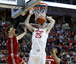 Ohio State forward Kyle Young, center, dunks the ball between Wisconsin forward Ethan Happ, left, and forward Aleem Ford during the second half of an NCAA college basketball game in Columbus, Ohio, Sunday, March 10, 2019. Wisconsin won 73-67 in overtime. (AP Photo/Paul Vernon)